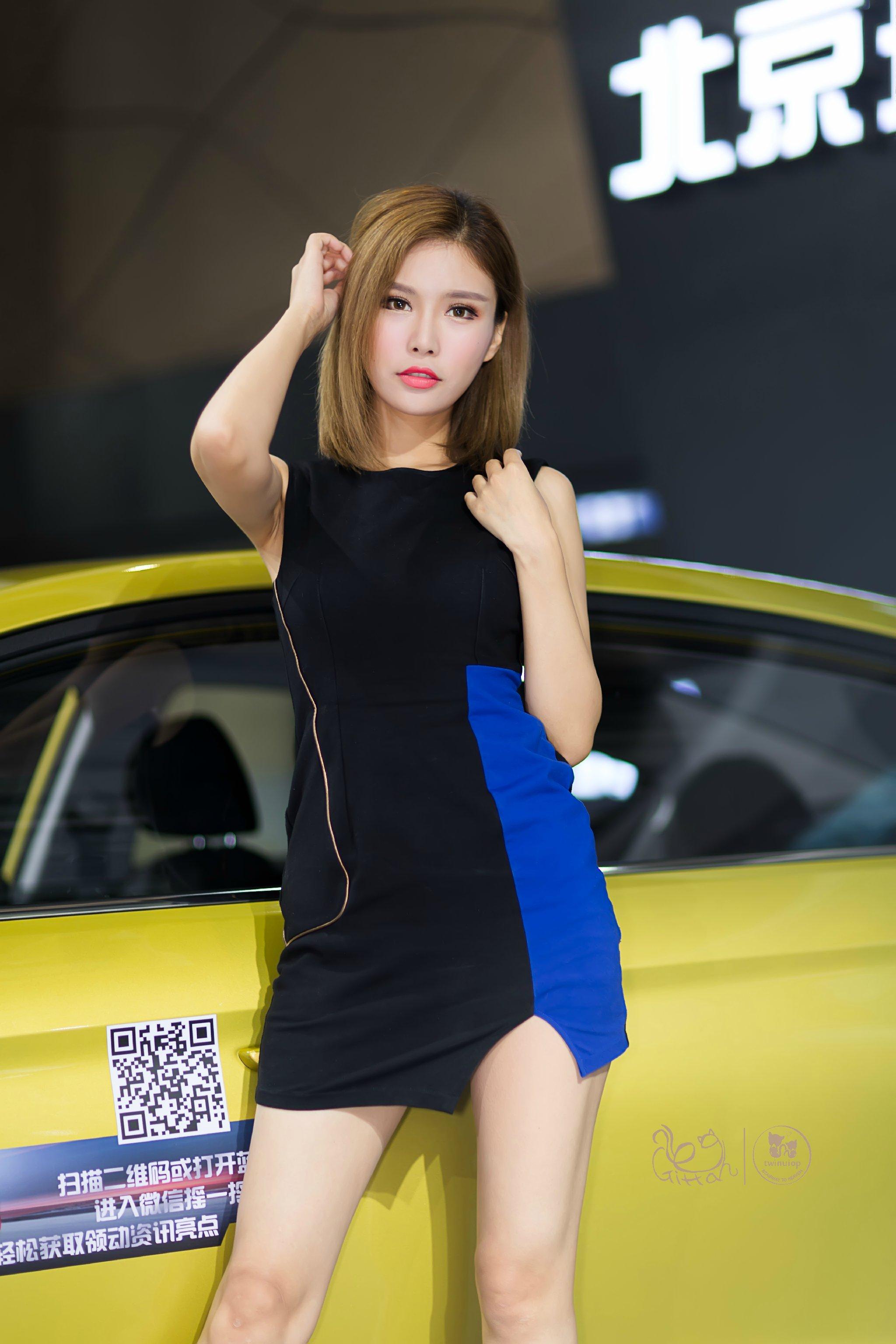 2016哈尔滨春季车展北京现代展台美女车模罗兰黑色连身裙美腿诱惑